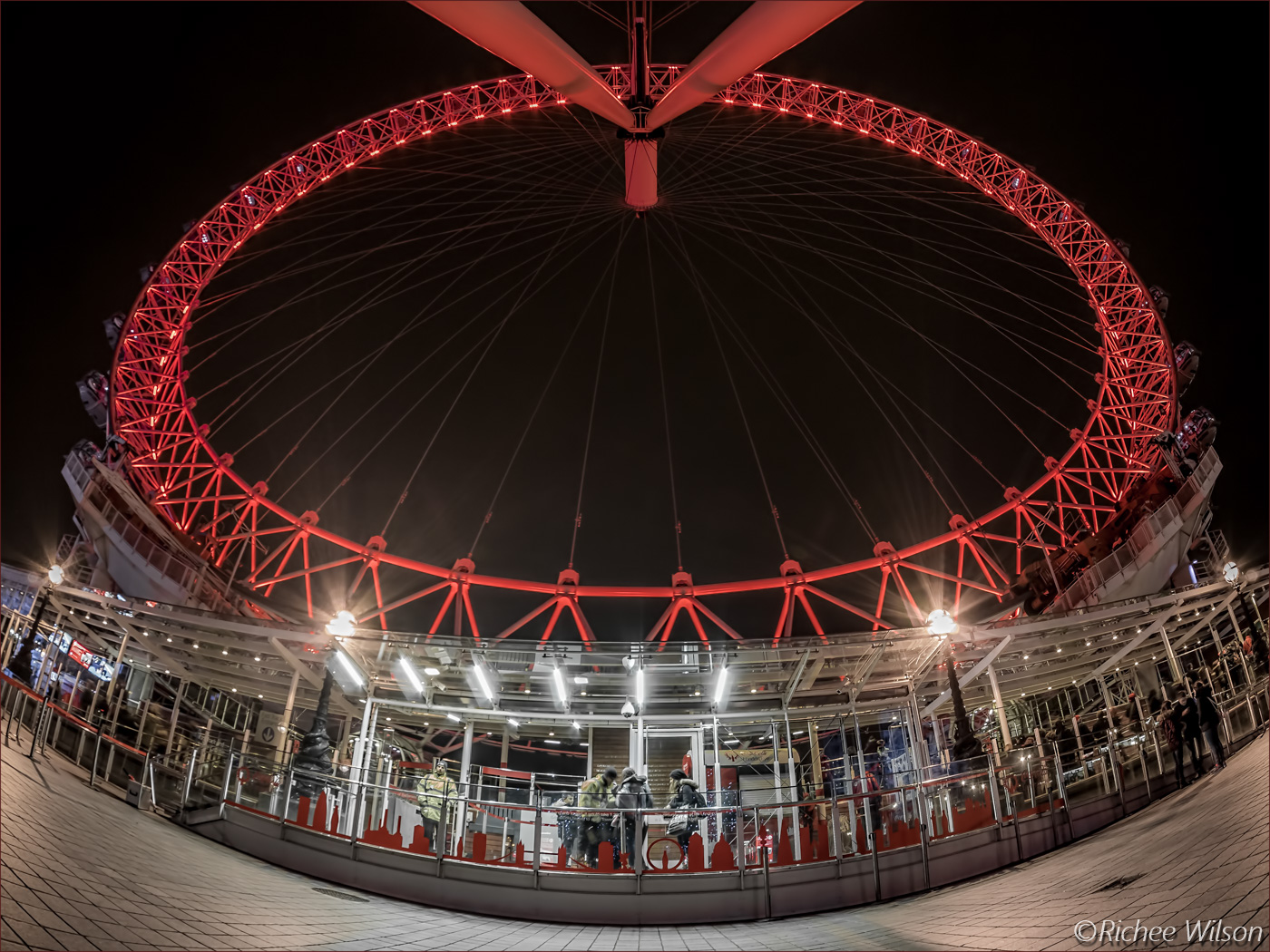 The London Eye and a security guard