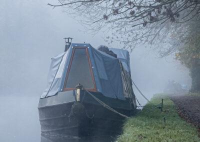 Long boat in mist